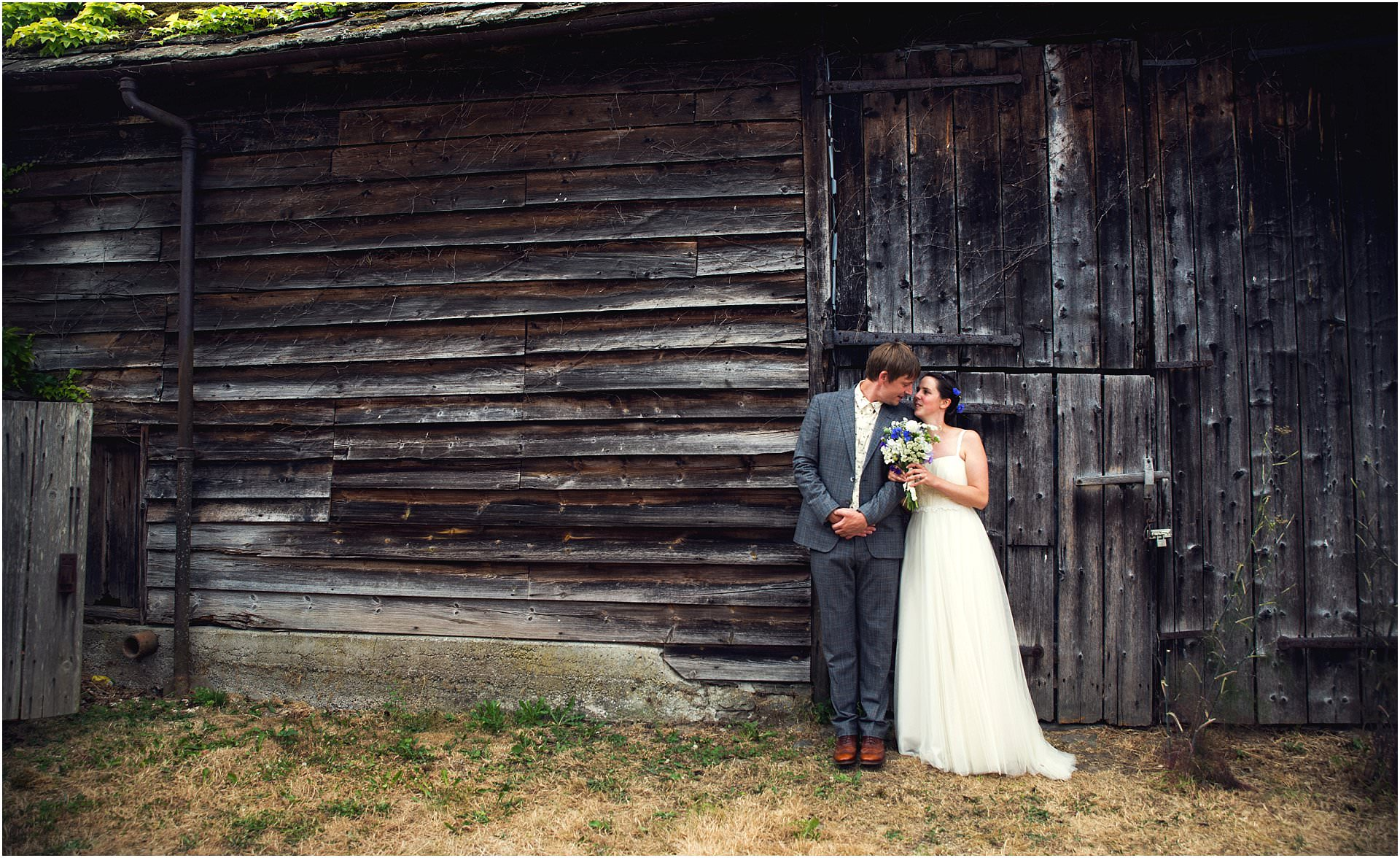 married couple and barn