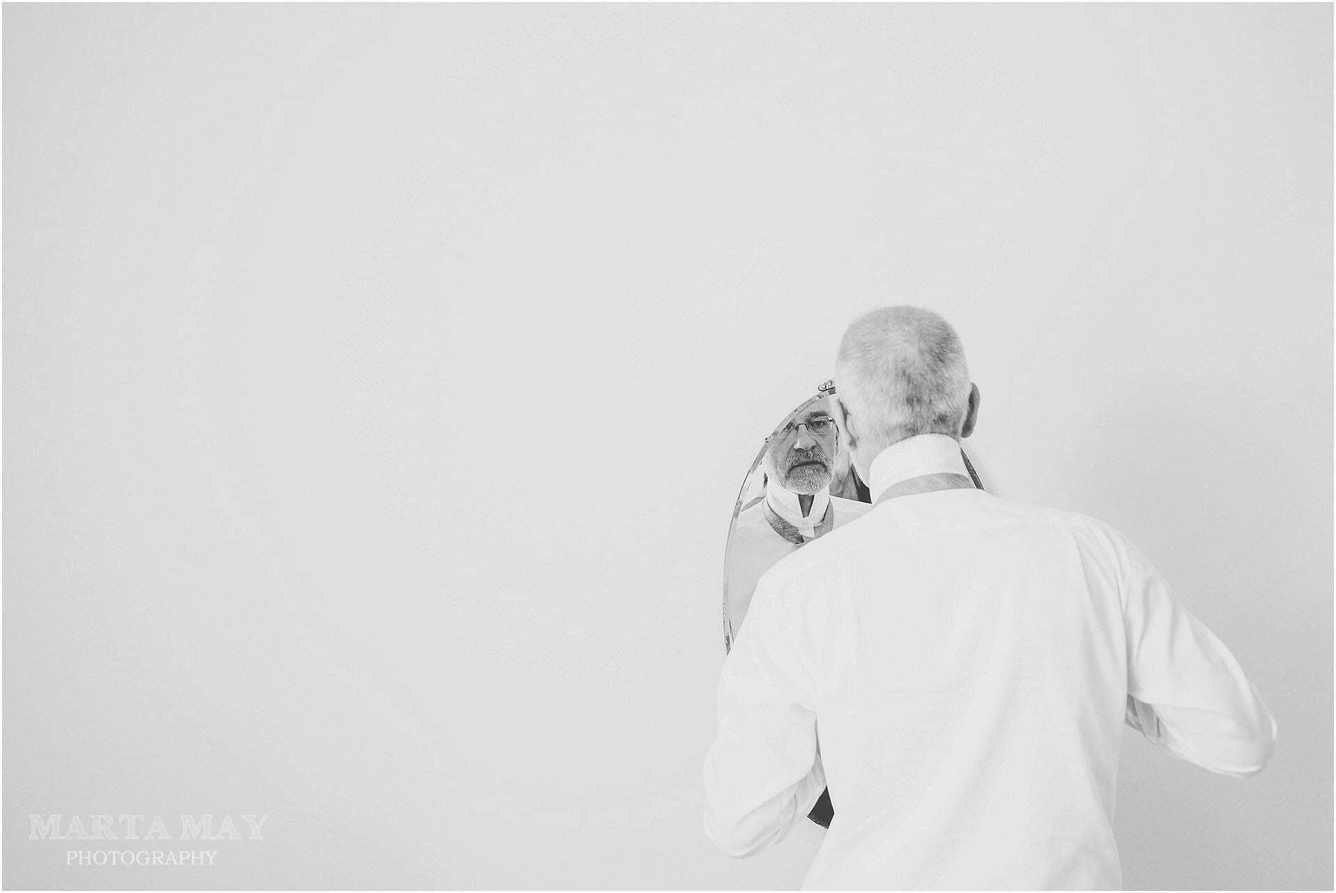 bride's dad getting ready