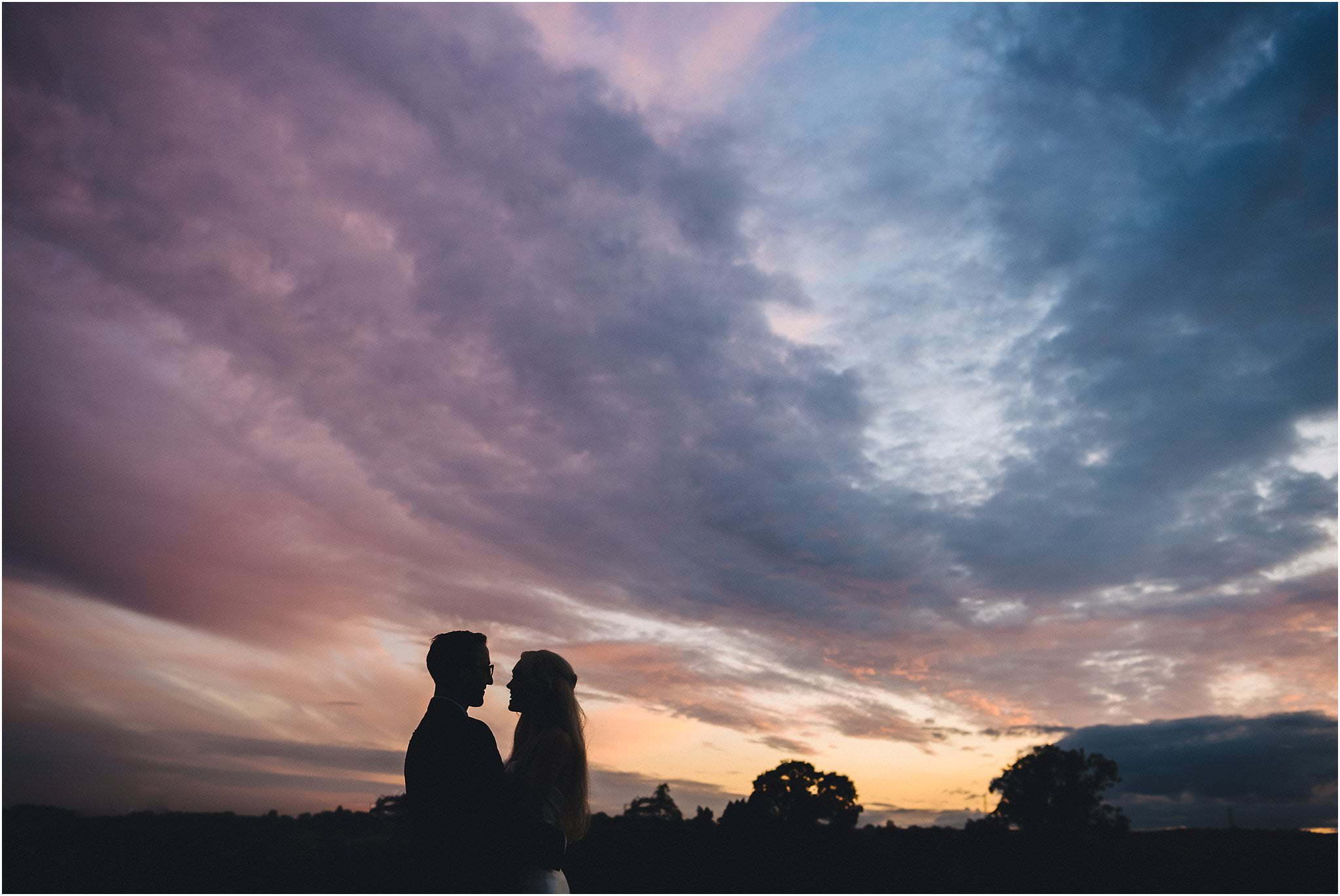 married couple and sunset