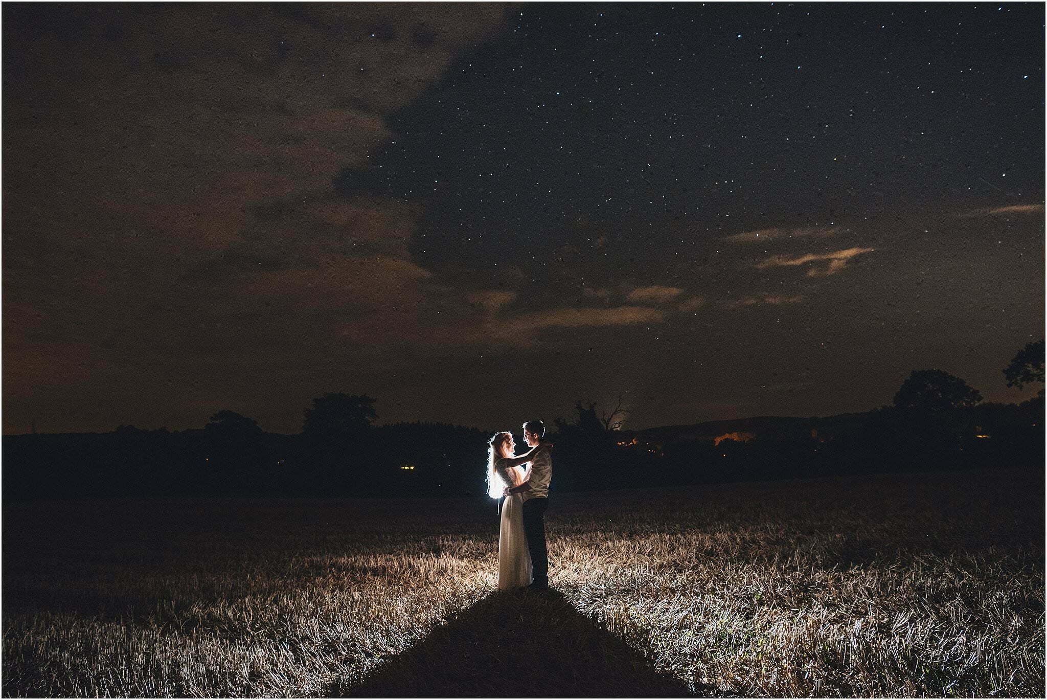 night portrait of bride and groom