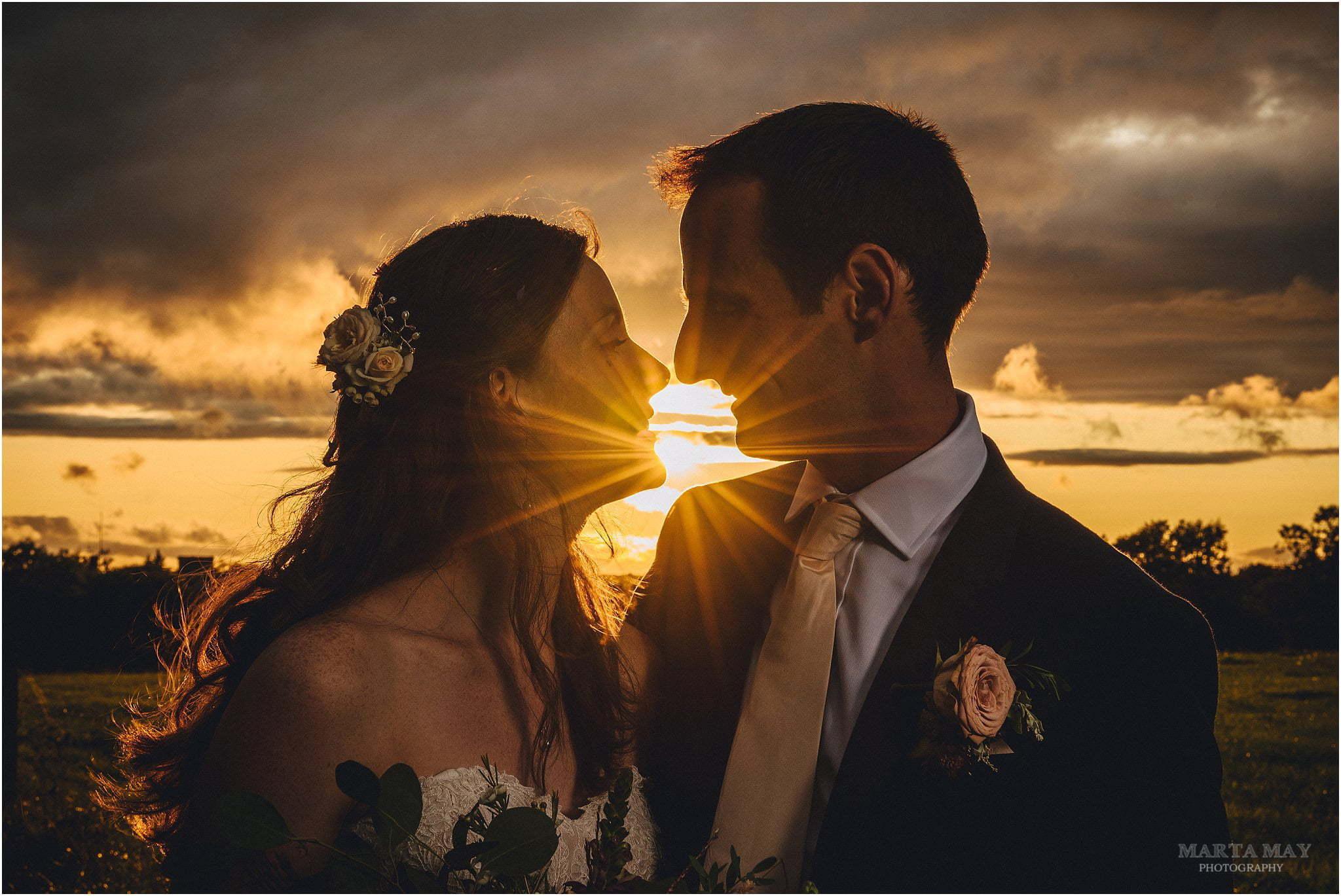 couple sunset Great Tythe Barn